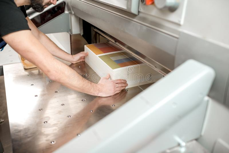 Cutting a stack of paper for printing at the factory royalty free stock images