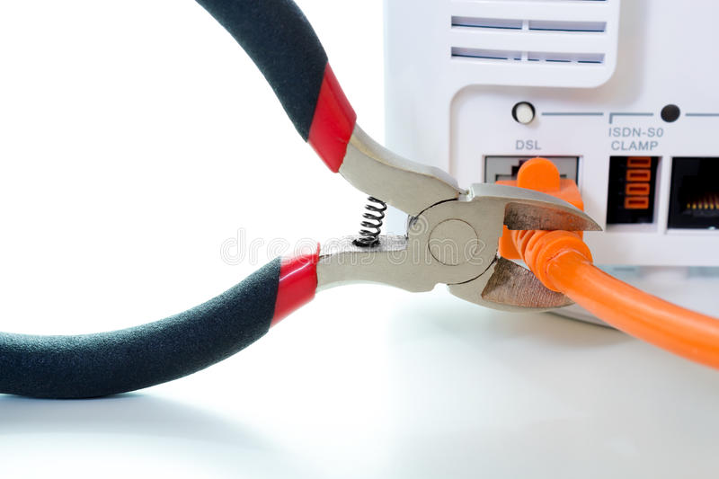 Cutting throug DSL cable. With side cutter royalty free stock photo