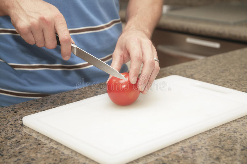 Cutting a tomato royalty free stock photo
