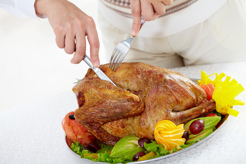 Cutting turkey stock image