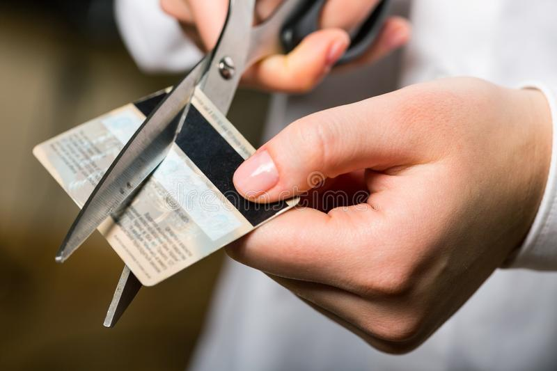 Cutting up credit card with scissors royalty free stock photography