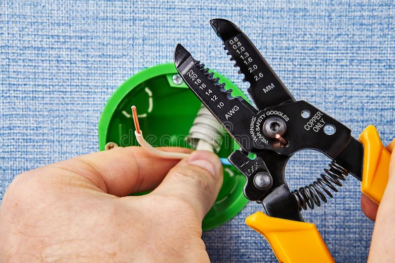 Cutting wires with stripper tool royalty free stock images