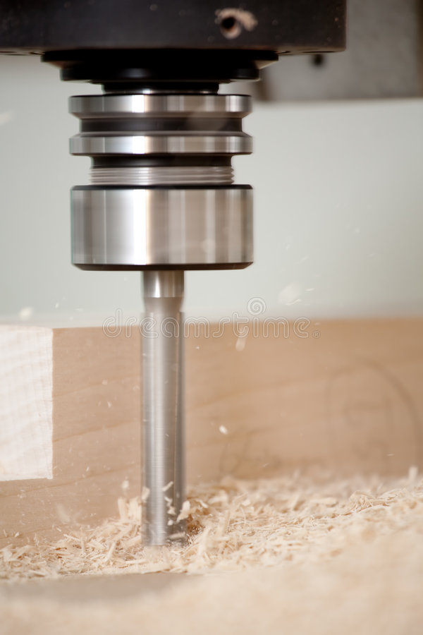 Cutting wood on CNC milling stock photos