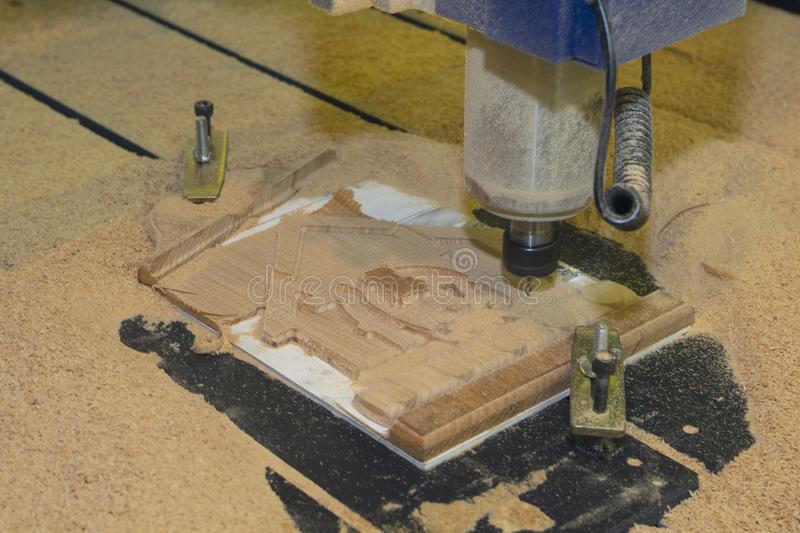 Cutting wood on a CNC milling machine close-up royalty free stock photography