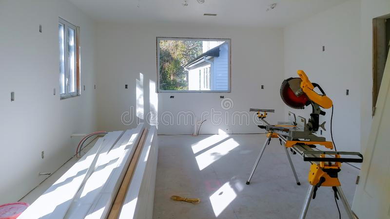 Construction remodeling home cutting wooden trim board on with circular saw. Cutting wooden trim board on with circular saw works on remodeling home contractor royalty free stock photo