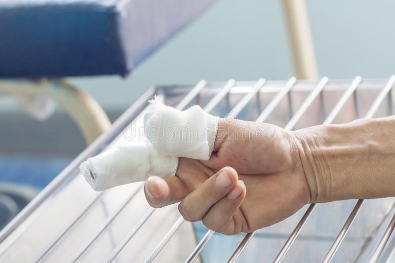 Cutting finger wound. Cutting wound finger, closeup dressing royalty free stock image