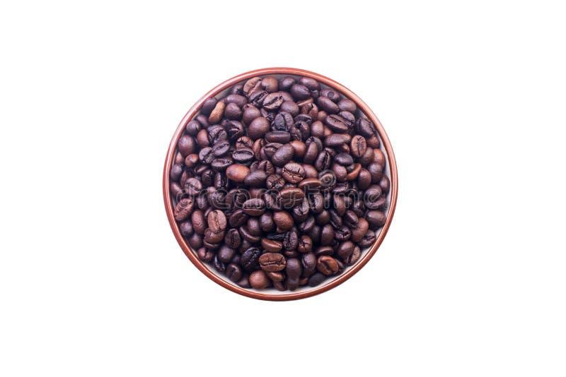 Cuvette en céramique avec des grains de café photo libre de droits