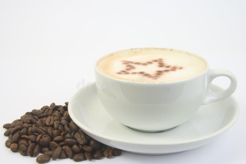 Cuvette et étoile de café photographie stock libre de droits