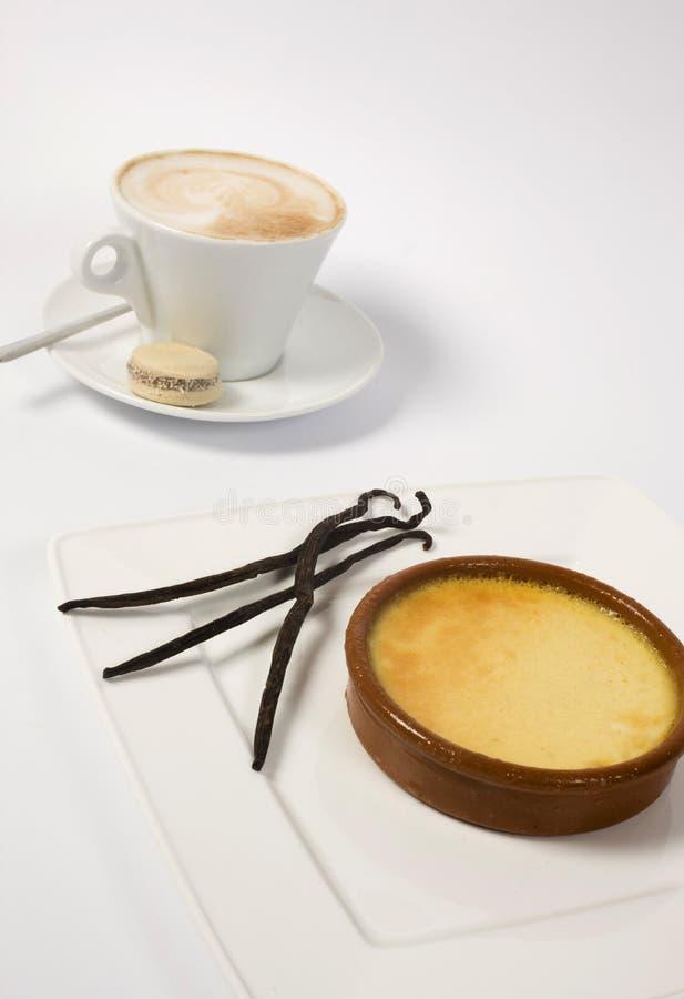 Cuvette et crème de café image stock