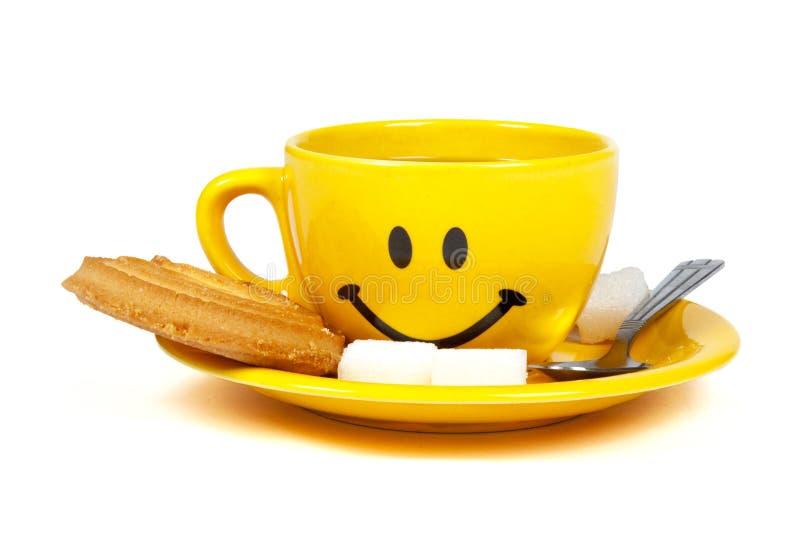Cuvette heureuse de thé photo stock