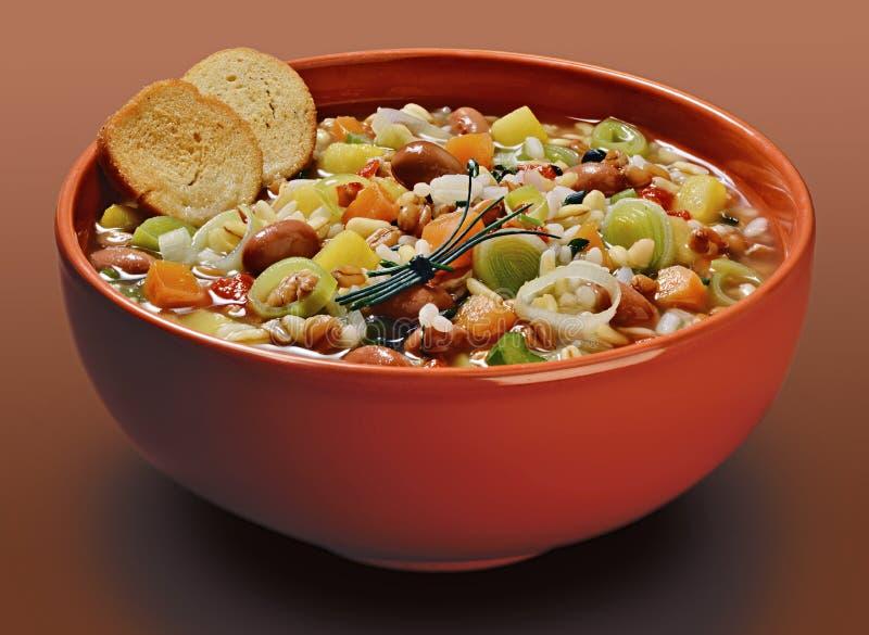 Cuvette orange avec des céréales et la soupe et les haricots à poireau de légumes avec images libres de droits