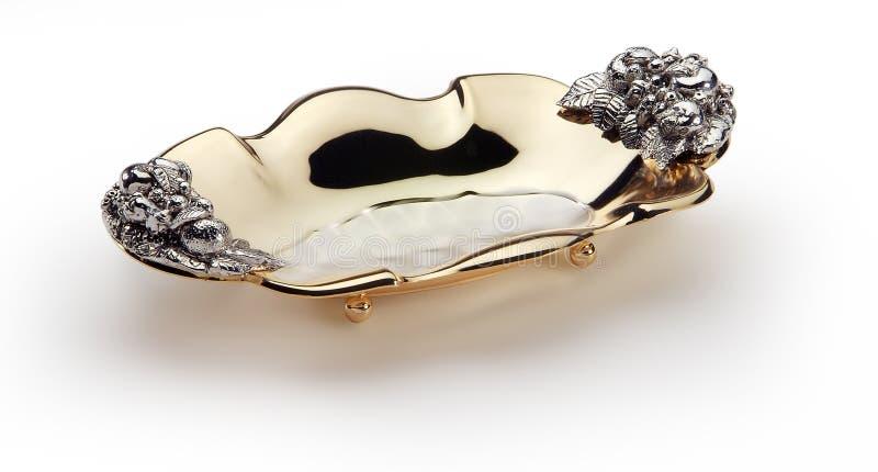 Cuvette ovale en acier et or décorés photographie stock libre de droits