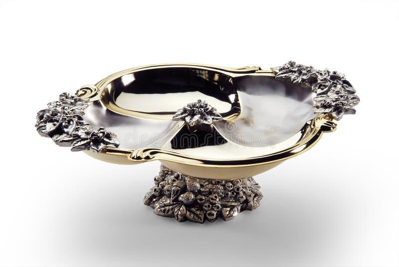 Cuvette ovale en acier et or décorés du pied central images libres de droits