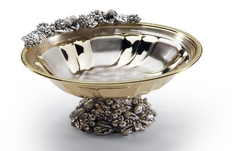 Cuvette ronde en acier et or décorés du pied central image stock