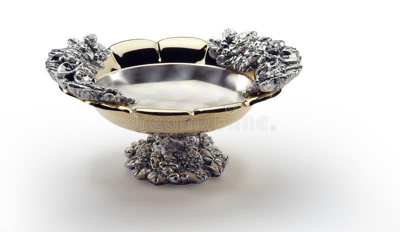 Cuvette ronde en acier et or décorés du pied central photos libres de droits