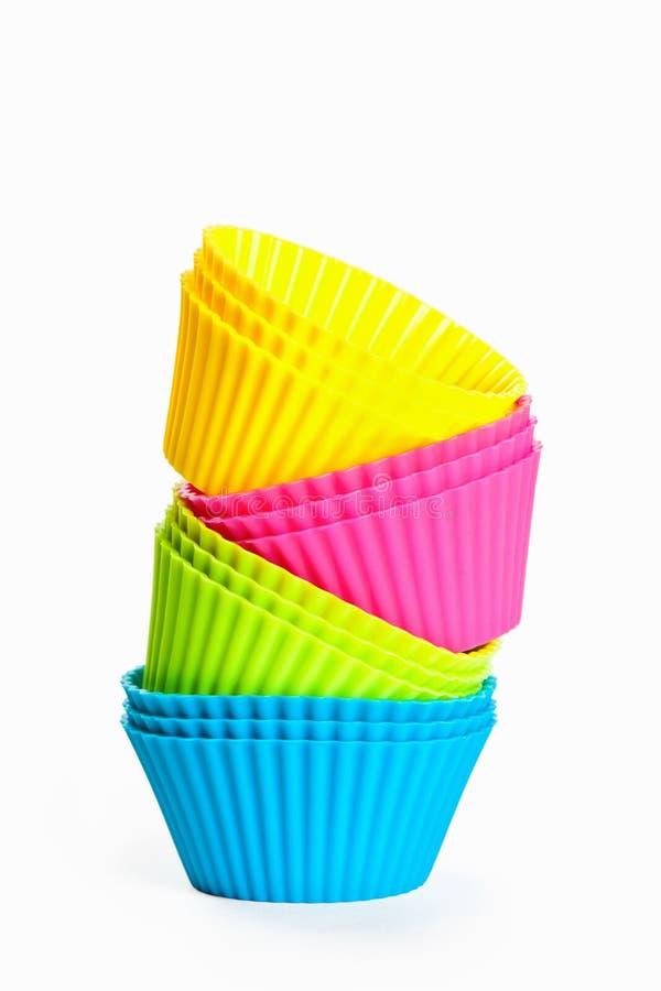 Cuvettes de silicones de cuisson pour des petits gâteaux ou des petits pains images libres de droits