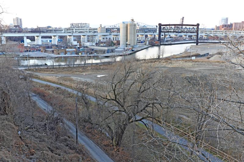 The Cuyahoga River in Cleveland, Ohio, USA in the heart of the rustbelt. Drab January day in Cleveland, Ohio, USA when the winter browns enveloped the city. The royalty free stock image