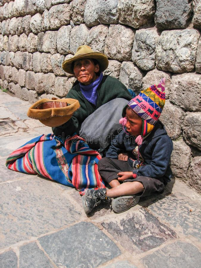 `Cuzco, Peru, January 10, 2010: woman and child on the street.` royalty free stock images