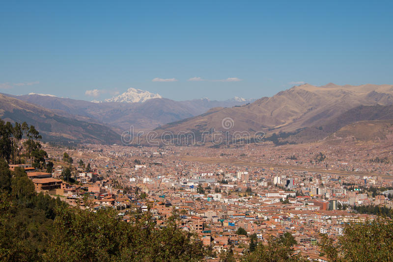 Cuzco with snow-capped mountain stock images