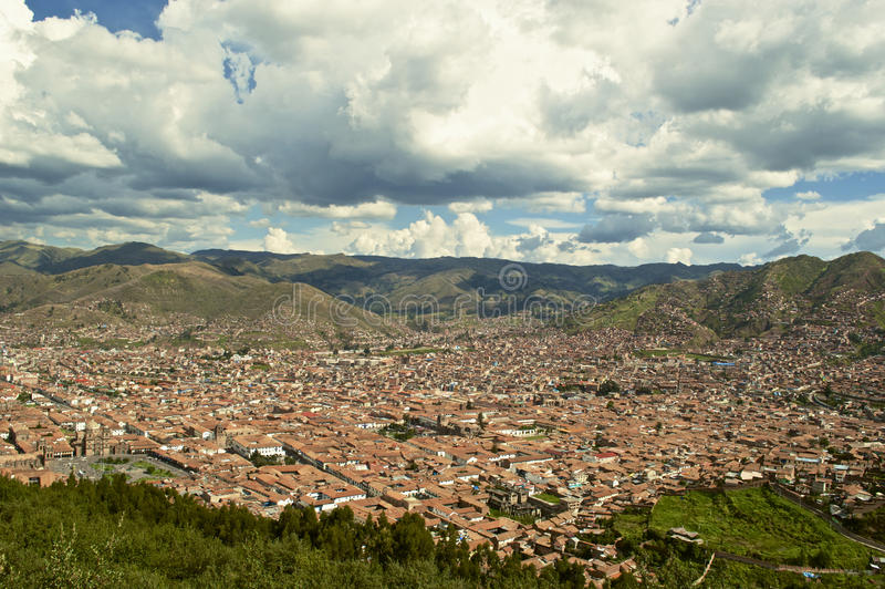 Cuzco. View from above of the Unesco World Heritage Site city of Cuzco in Southern Peru showing uniformity of red roofs and cloud formation stock photo