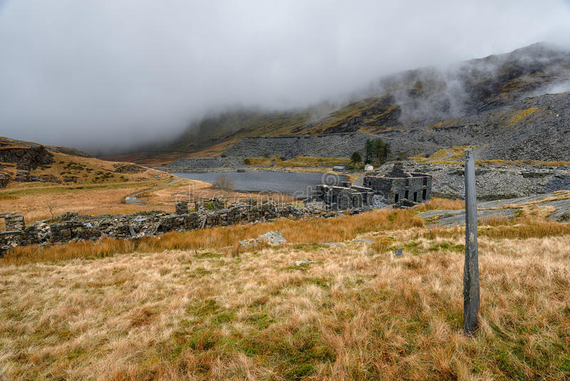Cwmorthin Slate Quarry. The ruins of abandoned cottages at Cwmorthin Slate Quarry at Tanygrisiau in north Wales royalty free stock photos