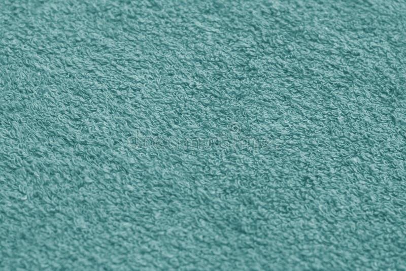 cyaan de oppervlakteclose-up van de kleurenhanddoek met onduidelijk beeldeffect stock afbeelding