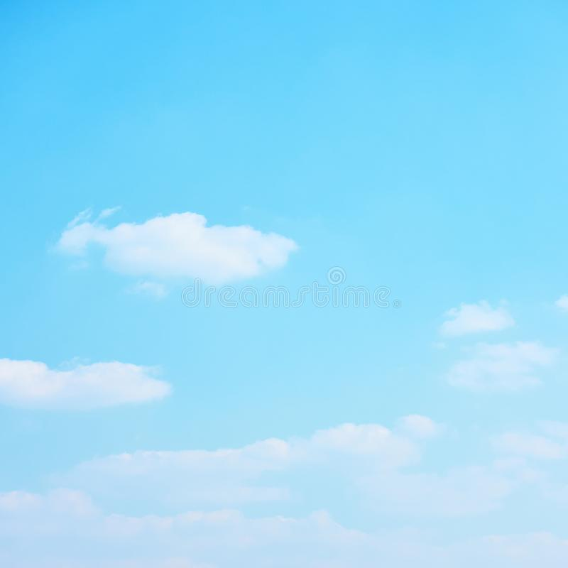 Cyan blue sky with clouds stock image