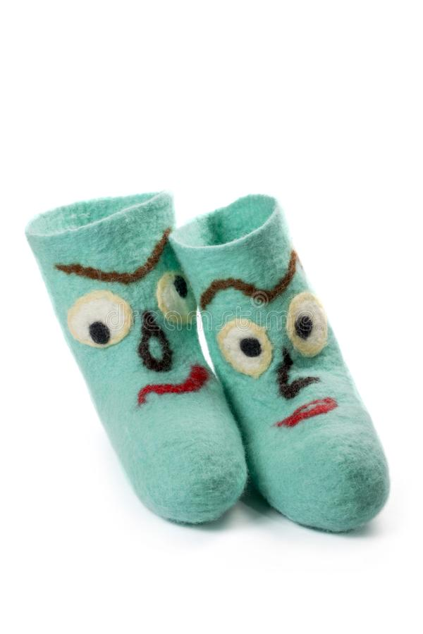 Cyan felt socks with a pattern. On a white background stock photo