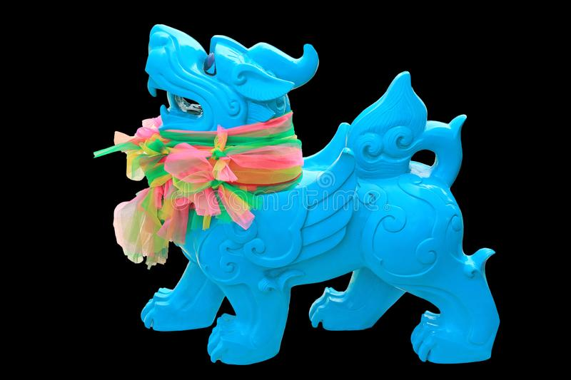 Cyan Imperial Chinese lion statue isolated on black background.  stock photo