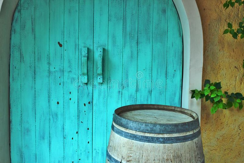 Cyan Old Wooden Door Yellow Wall Branch and Barrel Background. Cyan Old Wooden Door Yellow Wall Branch Barrel Background Traditional Interior Exterior Design stock photo