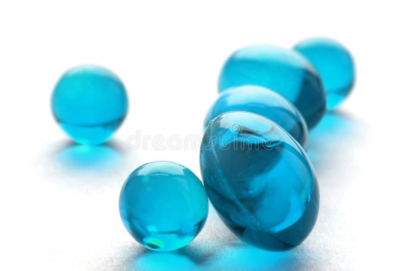 cyan pills för abstrakt färg royaltyfri fotografi