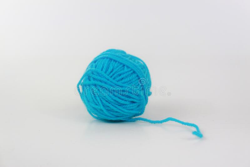 Cyan yarn with curl isolated on white background stock photography
