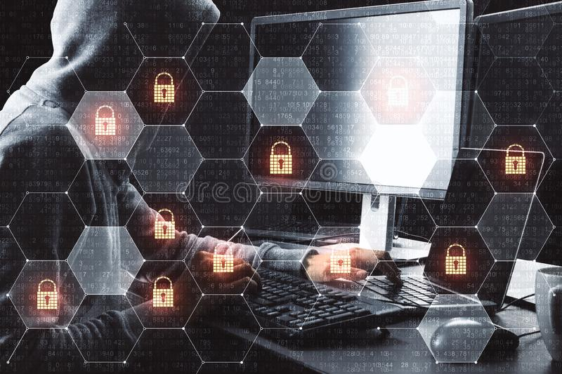 Cyber attack in process with hacker using laptop stock images