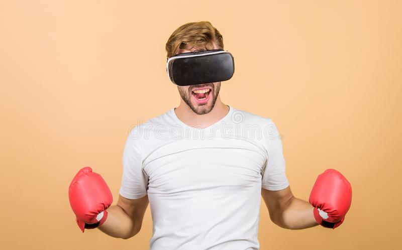 Cyber coach online training. Explore cyber space. Cyber sportsman boxing gloves. Man play game in VR glasses. Cyber royalty free stock photo