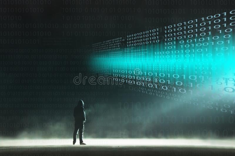 A cyber crime concept of a lone hooded figure looking at glowing numbers on a dark misty night stock photography