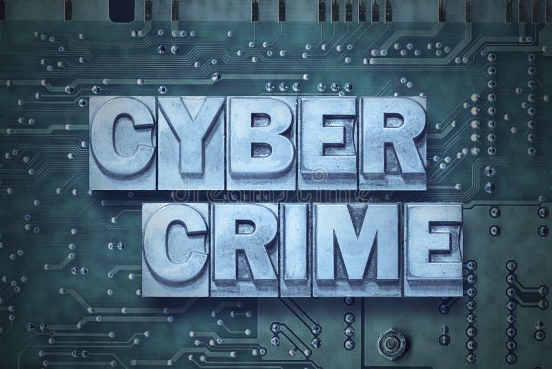 Cyber crime pc board. Cyber crime phrase made from metallic letterpress blocks on the pc board background stock photo