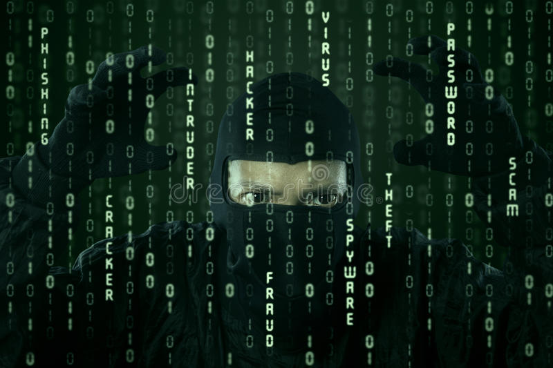 Cyber criminal. Hacker looking for password and user information stock photos