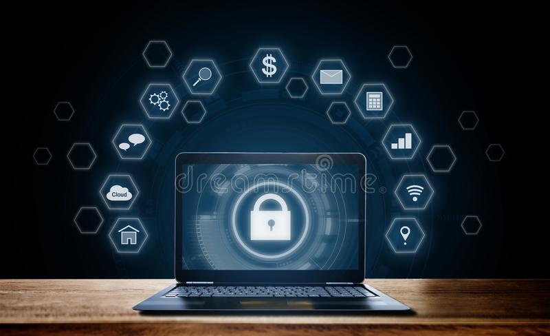 Cyber internet security system. Lock and application icons technology with computer laptop on wooden desk royalty free stock image