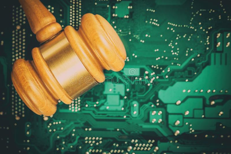 Cyber law and crime concept. Judge court gavel on computer PC motherboard stock photos