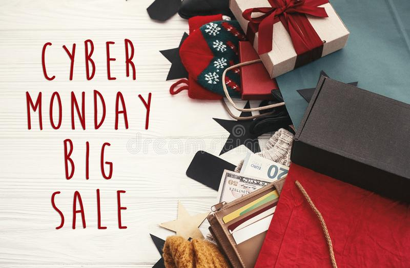Cyber Monday big sale text sign. Special discount christmas offer. Christmas shopping. Gift boxes, credit cards and money in wall. Et, bags, clothes, tags on stock image