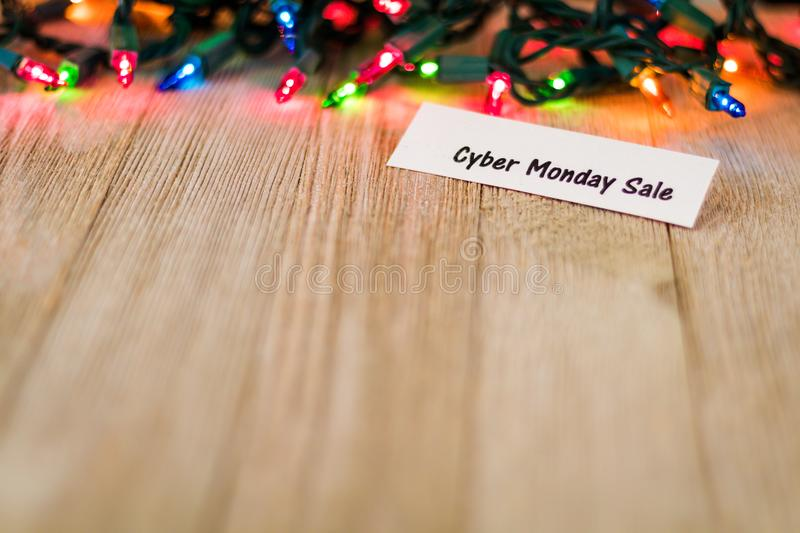 Cyber Monday List concept on wooden board and colored lights, selective focus, room for copy. Sale Concept on wooden board and colored lights, selective focus royalty free stock images