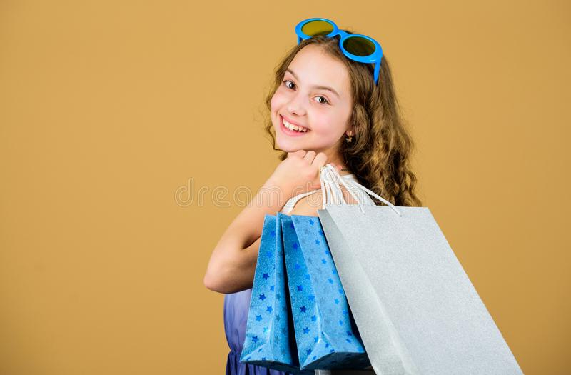 Cyber Monday. Present and gifts buy. summer sales. Small girl fashion. happy shopping girl with bags. black Friday stock image