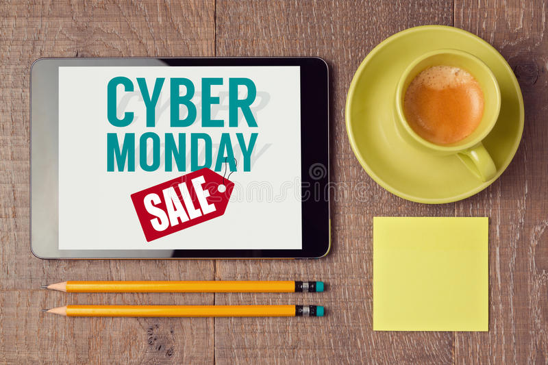Cyber Monday sign on digital tablet with coffee cup. Holiday online shopping concept. View from above stock photos