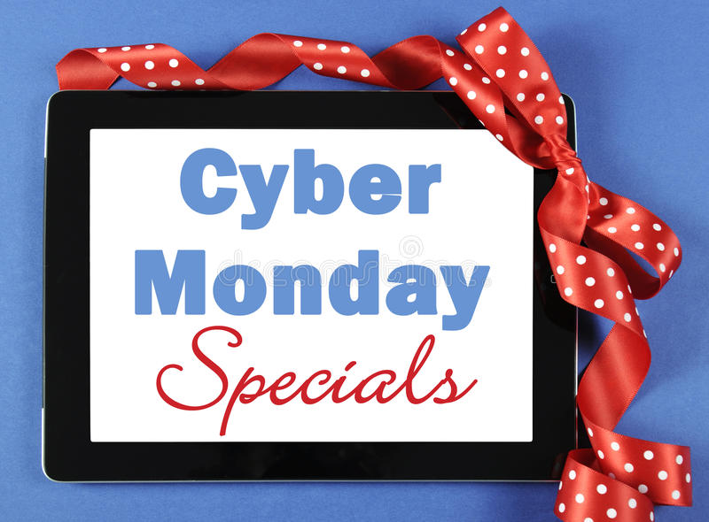 Cyber Monday on tablet device wrapped as a gift. royalty free stock photo