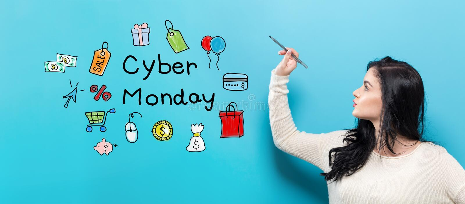 Cyber Monday with young woman holding a pen royalty free stock photos