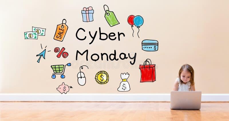 Cyber Poniedziałku tekst z małą dziewczynką używa laptop zdjęcie stock