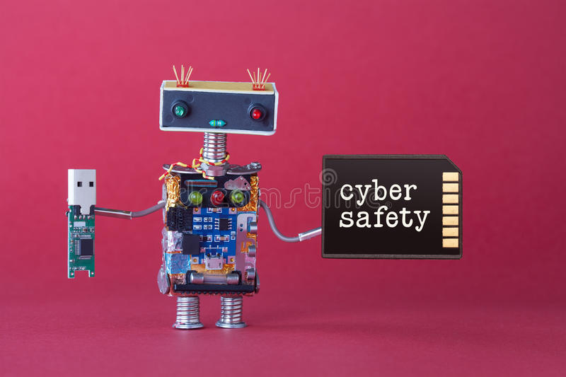 Cyber safety data storage concept. System administrator robot toy with usb flash stick and memory card on red background. Copy space macro view photo royalty free stock photography