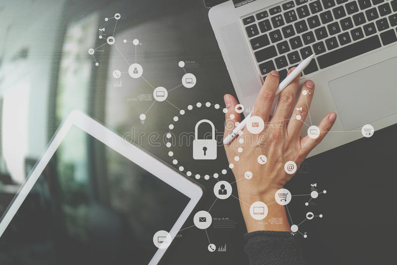 Cyber security internet and networking concept.Businessman hand. Working with VR screen padlock icon on laptop and digital tablet computer royalty free stock images