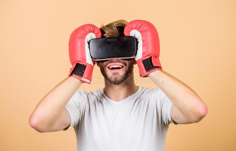 Cyber sport concept. Cyber coach online training. Cyber sportsman boxing gloves. Augmented 3D world. Man boxer virtual. Reality headset simulation. Man play royalty free stock photos