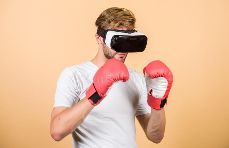 Cyber sportsman boxing gloves. Man play game in VR glasses. Cyber sport concept. Man boxer virtual reality headset. Simulation. Cyber coach online training stock images